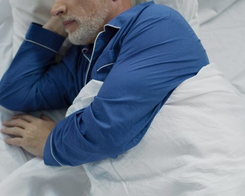 Elder lying in bed, unable to calm down and fall asleep, lack of comfort, stock footage