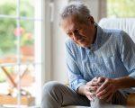 Senior man with knee pain