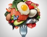 Eating ketogenic food and Keto nutrition lifestyle diet low carb and high fat meal as fish nuts eggs meat avocado and other healthy ingredients as a therapeutic snacks on a fork with 3D illustration elements.