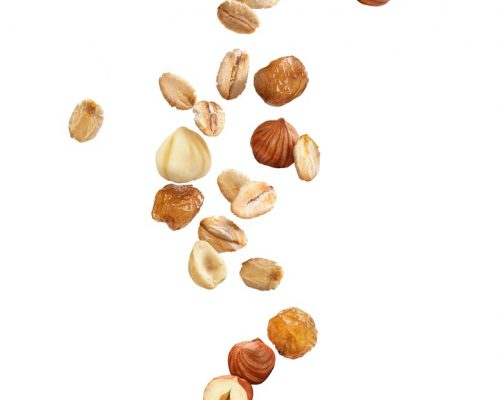 oatmeal with nuts and raisins on a white background