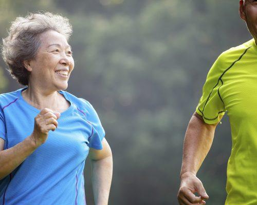 Happy Senior Couple jogging in the nature park