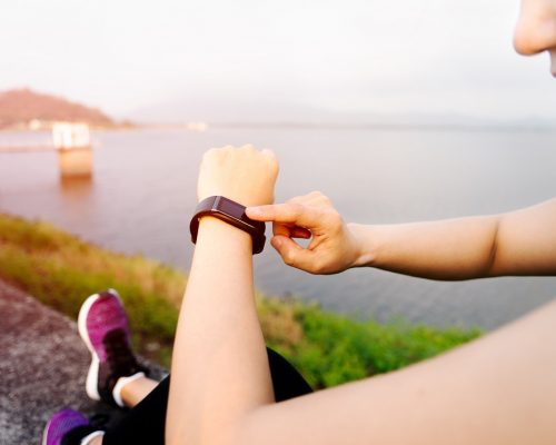 smart band, women touching fitness smart band after workout