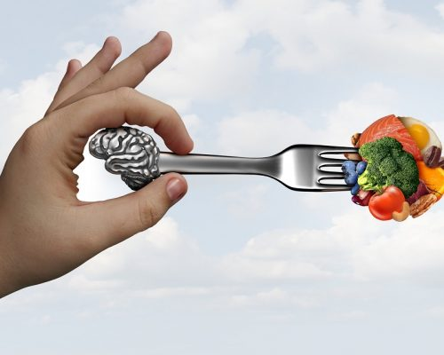 Brain food nutrition concept as a group of nutritious nuts fish vegetables and berries rich in omega-3 fatty acids with vitamins and minerals for mind and memory health with 3D illustration elements.